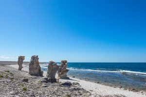 """Cliff formations at the rocky coast of Fårö island in Gotland, Sweden. These cliffs are called """"rauk"""" in Swedish."""